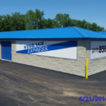 Outdoor storage unit building with drive-up access