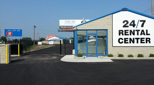 Storage facility entrance and sign that says 24/7 rental center
