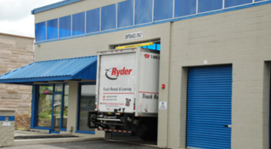 Moving truck pulling into storage facility