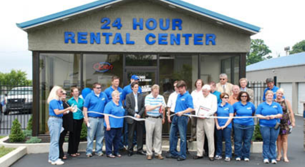 Storage Express employees cutting ribbon for facility grand opening