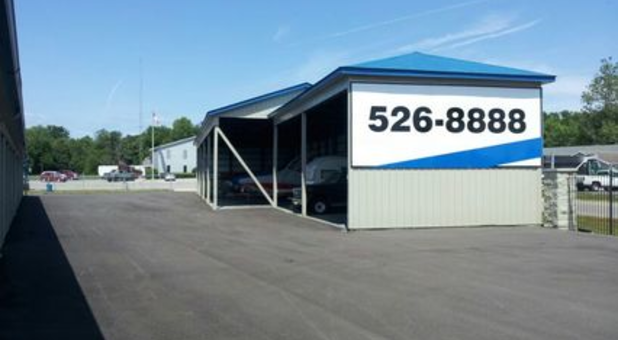 Storage building with phone number on the side 526-8888