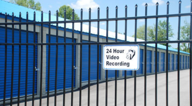 Sign on gate that says 24 hour video recording