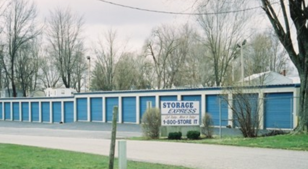 Row of outdoor storage units with drive-up access
